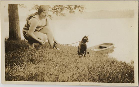 fp3540(Woman_Lakeside_CatOnLeash)
