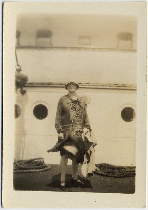 ROBUST WIND-BLOWN WOMAN in HAT on BOARD OCEAN LINER!
