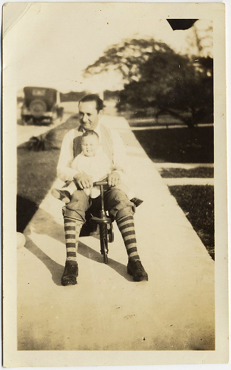 CRAZY DAD w STRIPED SOCKS & TODDLER on LAP on KIDS BIKE