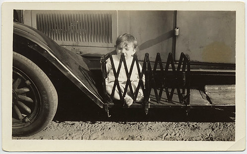 BABY FENCED IN by CONCERTINA ENCLOSURE on RUNNING BOARD of VINTAGE CAR