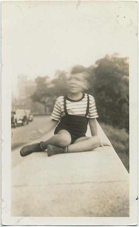 BLURRY BOY in STRIPES & CUTE SUSPENDERS on BRIDGE PARAPET SHAKES HEAD