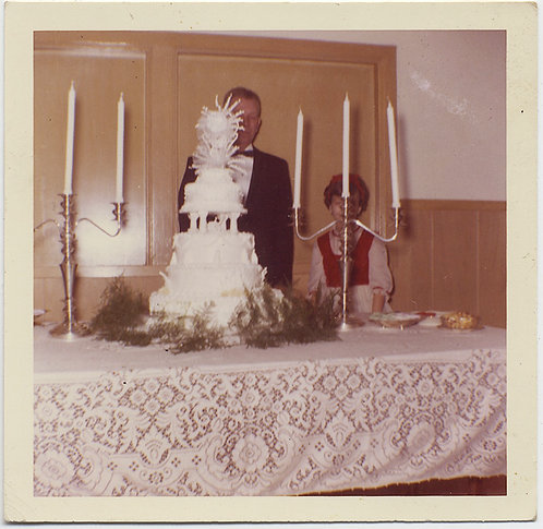SUPER BADLY FRAMED PHOTO of WEDDING CAKE HIDES KIDS BEHIND CANDLES