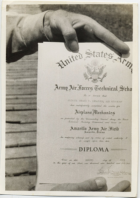 The GRADUATE! DISEMBODIED HAND HOLDS US ARMY AIRPLANE MECHANICS DIPLOMA