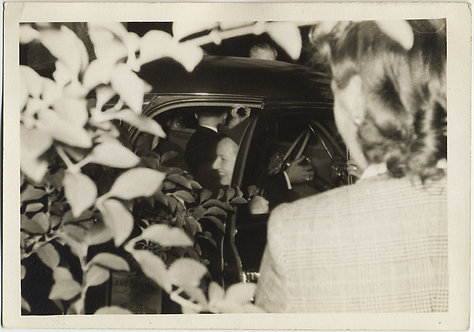 COMPLEX COMPOSITION WOMAN in CAR FACING AWAY fm DRIVER FRAMED by LEAVES FLASH