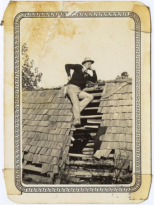 FEY MAN in RAKISH HAT and ATTITUDE poses on ROOF!