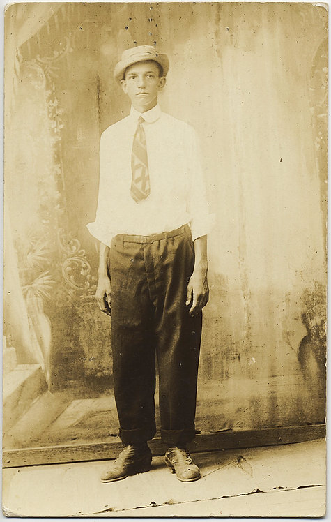 RPPC GLOWING YOUNG MAN PORKPIE HAT ILL FITTING TROUSERS SHIRT PAINTED BACKDROP