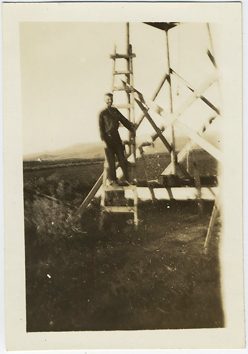 IMPRESSIONISTIC  BLURRY MAN STANDS on WOODEN STRUCTURE LADDER