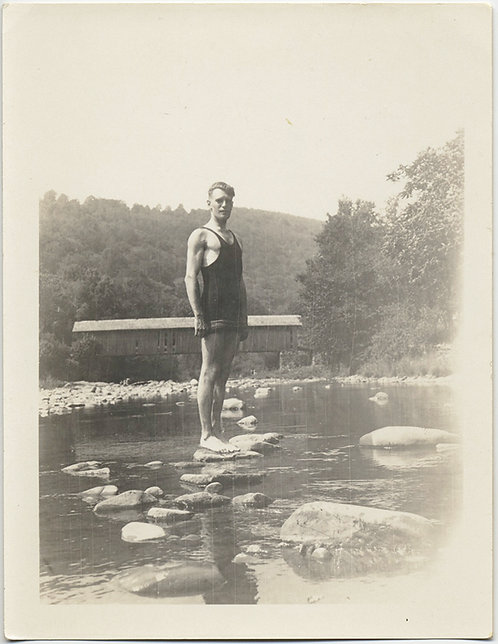 SWIMMER stands on ROCKS by COVERED BRIDGE!