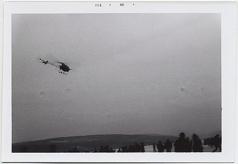 MENACING HELICOPTER FLIES over CROWD on ICY LANDSCAPE Feb 69 STRANGE