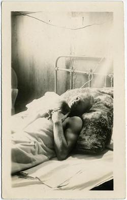 fp1266 (Blonde Man in Metal Bed)