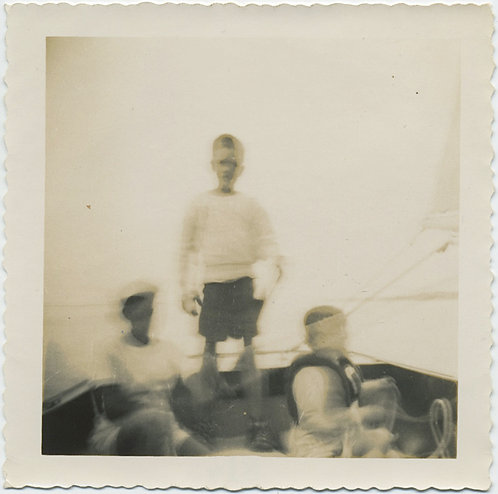 IMPRESSIONISTIC SPECTRAL GHOST LIKE BOY STANDS up IN BOAT w KIDS