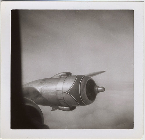 BEAUTIFUL MINIMALIST VINTAGE AIRPLANE ENGINE PROPELLER seen ABOVE CLOUDS
