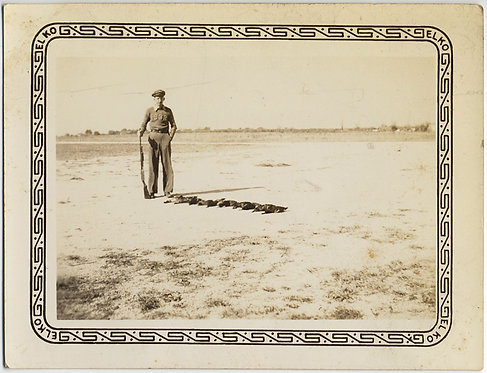 DUCK BIRD HUNTER STANDS on BARREN PLAIN w DEAD BIRDS RIFLE GUN ELKO