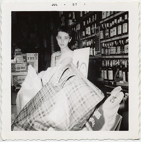 YOUNG ELFIN WOMAN at LIQUOR STORE COUNTER w PILED UP BAGS 1957