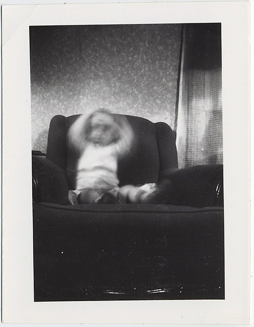 HAUNTING GHOST CHILD THRASHES on EASY CHAIR MOVEMENT BLUR HANDS UP