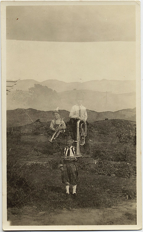 TUBA & TRUMPET PLAYING MAN & BOYS in ETHNIC DRESS in DOUBLE EXPOSURE LANDSCAPE