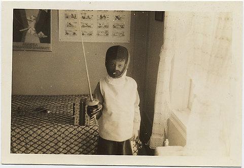 KID in FENCING GEAR SMOCK and HELMET and EPEE! EN GARDE!