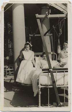 fp6513(BoyInHospitalBed_Nurses_FootSling_Outside)