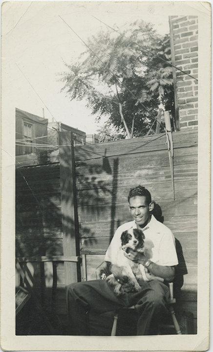 HANDSOME AFRICAN-AMERICAN? SE ASIAN? SWARTHY MAN & PRINCE CHARLES SPANIEL DOG