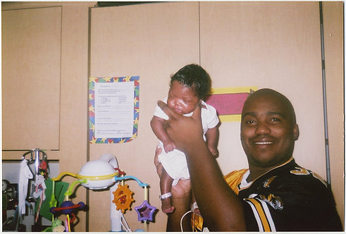 PROUD AFRICAN AMERICAN BLACK DADDY HOLDS up NEWBORN BABY GIRL