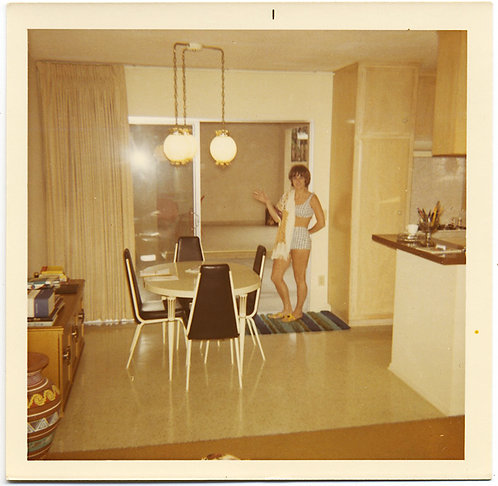 BIKINI TWO-PIECE SWIMSUIT WEARING WOMAN in MIDCENTURY MODERN KITCHEN DINING ROOM