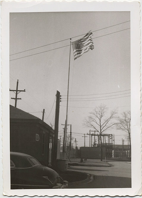 OLD GLORY AMERICAN FLAG FLIES over STREET TELEPHONE WIRES and POLES