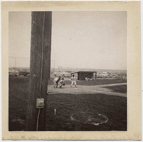 STRANGE SNEAKED PHOTO of BASEBALL GAME BEHIND TELEPHONE POST Omar McGee at bat