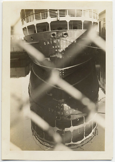 STUNNING SHIP & REFLECTION SEEN THROUGH CHAIN LINK FENCE