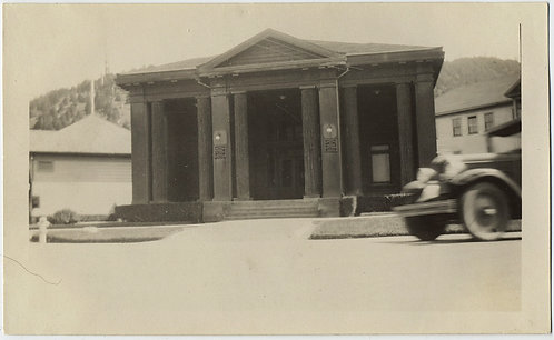 VINTAGE CAR DRIVES by BANK BUILDING in MOVEMENT BLUR MODERNIST COMPOSITION