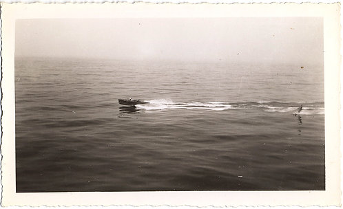 LOVELY VINTAGE SPEEDBOAT and WATERSKIER on PLACID OCEAN