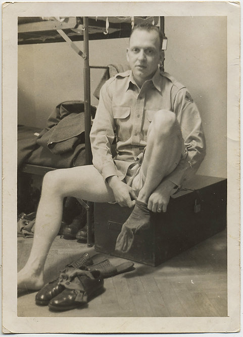 HALF NAKED SOLDIER without PANTS PUTS on SOCKS on TRUNK nr BUNK BED