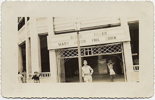 HANDSOME MAN POSES in front of BLOOD FEVER MARY ASTOR PHIL DORN MOVIE MARQUEE