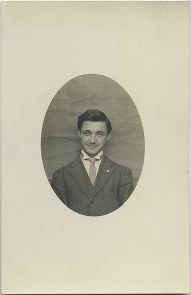 SEXY, HANDSOME MAN poses for formal portrait. RPPC