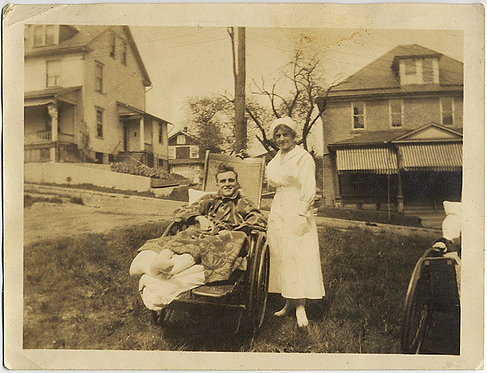 NURSE and HANDSOME PATIENT in WHEELCHAIR LEG CASTS on SUBURBAN LAWN