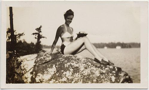 SEXY LOVELY WOMAN POSES on ROCK near LAKE in BIKINI SOFT FOCUS