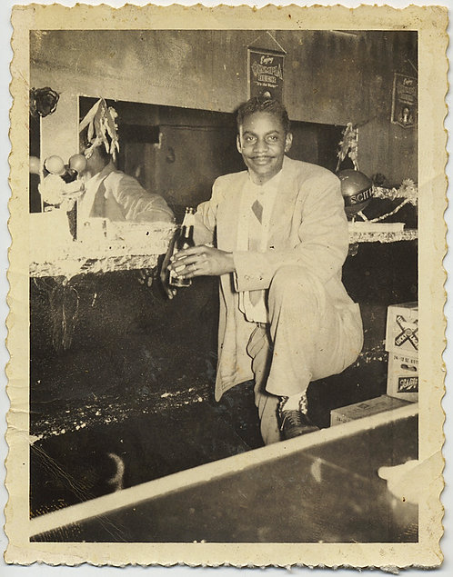 DAPPER SUAVE AFRICAN AMERICAN MAN with MOUSTACHE BEER in HAND at BAR