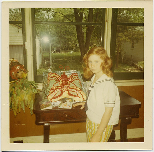 YOUNG GIRL WITH RED GINGER HAIR & SUPREMELY UGLY MISSHAPEN LOBSTER BIRTHDAY CAKE