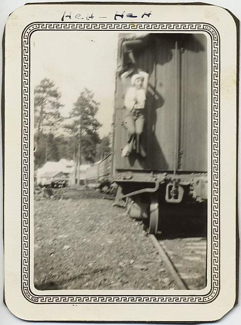 """""""Heh-Heh"""" CRAZY WOMAN HANGS OFF REAR of RAILWAY CAR"""