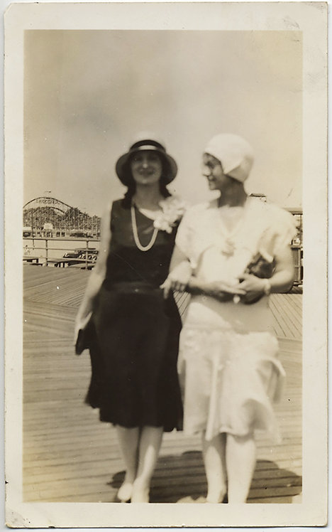 LOVELY FLAPPER WOMEN BLACK & WHITE SOFT FOCUS on BOARDWALK ROLLERCOASTER BEHIND