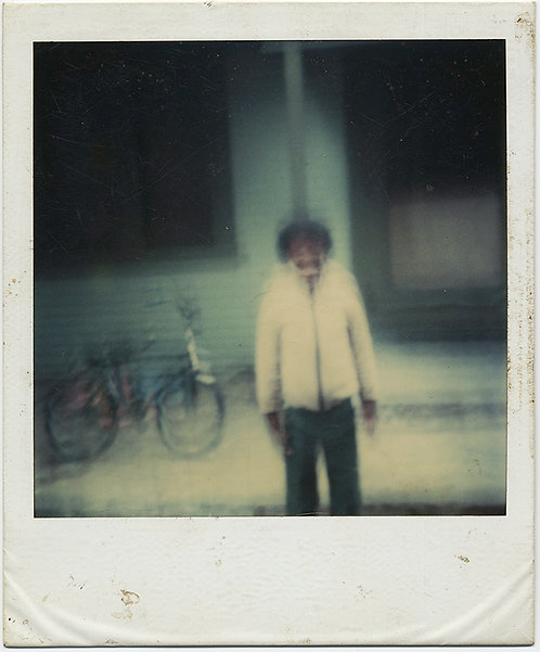 JITTERY POLAROID makes AFRICAN AMERICAN MAN & BIKE look SURREAL