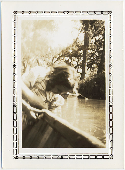 GORGEOUS AND MOODY! CURIOS LANGUID GIRL floats touching RIVER in BOAT!