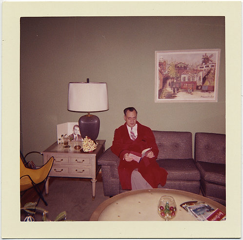MAN w BAGS under EYES in SUPER RED ROBE in AWESOME MID CENTURY INTERIOR