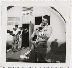 fp8800(Quonset-Hut-Man-Dog-Carry)