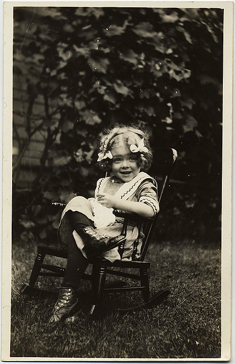RPPC GORGEOUS ADORABLE SMILING HAPPY EDNA w BOWS & BOOTS on KID ROCKING CHAIR!