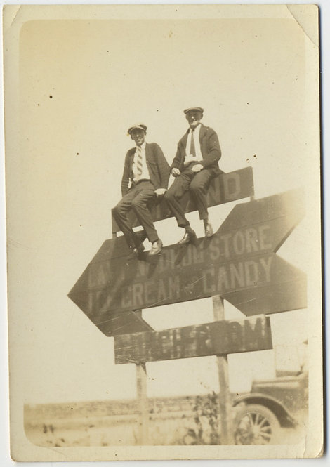 GREAT YOUNG MEN SIT atop ICE CREAM CANDY DRUG STORE ARROW SIGN