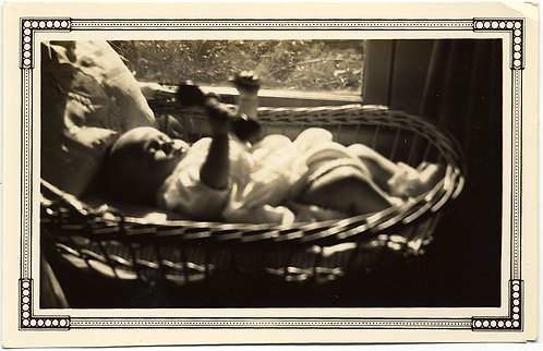 SUN DAPPLED INFANT in WICKER CRIB FLEXES w BARBEL RATTLE TOY