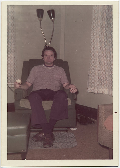 MAN in RECLINER w MID CENTURY MODERN LAMP GROWING OUT of HEAD OOPS
