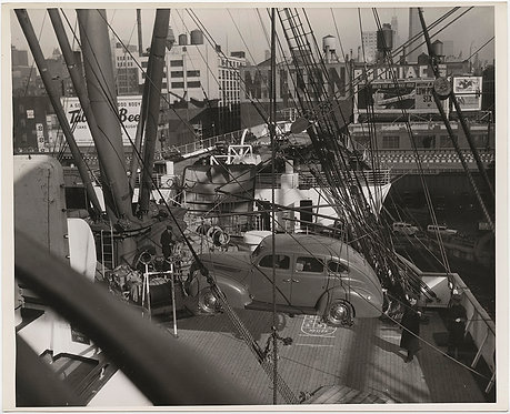 PRESS PHOTO VINTAGE CAR LOWERED onto DECK of NORMANDIE SHIP HARBOR GREAT SIGNAGE