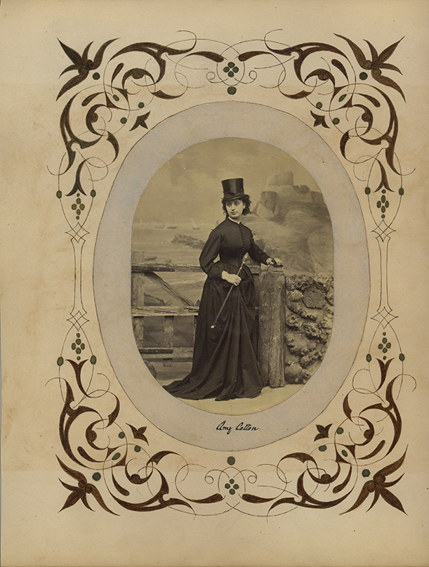 fp6325(Woman_TopHat_Fence_Border_CaptionAmyCotton)