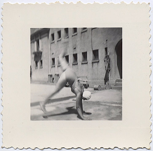 GIRL in SWIMSUIT GOES for BROKE HANDSTAND in BRUTALIST COURTYARD ACTION BLUR